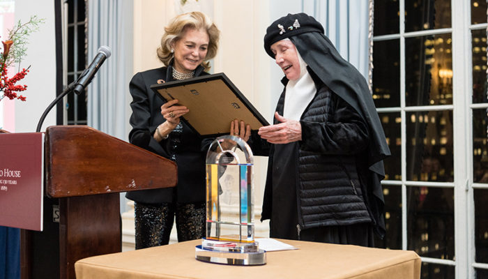 Maria Cooper Janis presents Pope Leo XIII Award to Mother Dolores Hart, OSB.