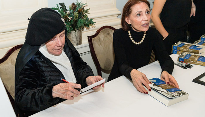 Mother Dolores Hart, OSB, signing autographs.